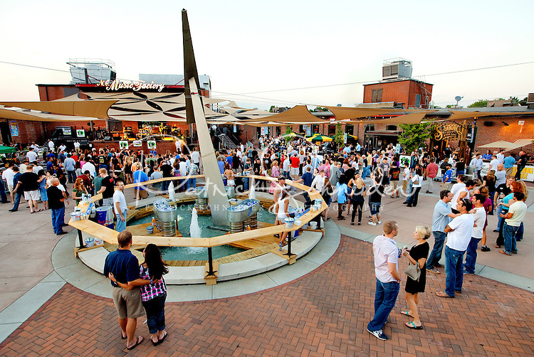 Charlotte's NC Music Factory, located in the Uptown Village at 935 N Graham, is a play, work, live destination of bars, restaurants, entertainment venues and more. It is a popular weekend destination for Charlotte nightlife. For research help in locating stock images or Charlotte NC photos available for purchase or licensing, please call 704-655-2661.
