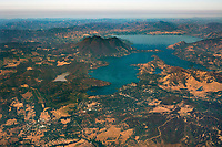 aerial photograph of an overview of Clear Lake from the City of Clearlake looking towards Mount Konocti, Lake County, California, Anderson Marsh is visible to the left of the City of Clearlake as is Cache Creek which drains Clear Lake.