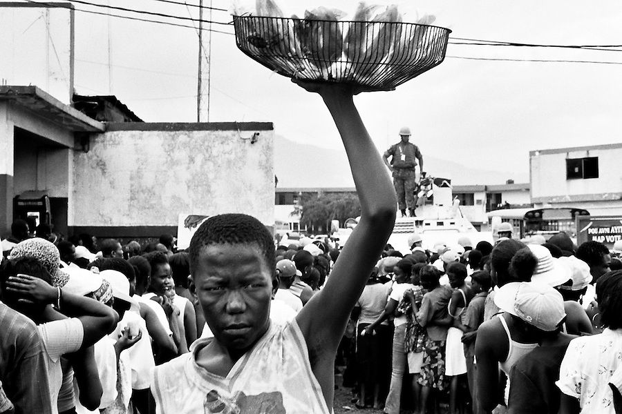 Haitian boy selling snacks outside the voting station closest to Cite Soleil on the day of the elections.