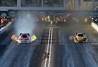 Feb. 22, 2013; Chandler, AZ, USA; NHRA funny car driver Bob Tasca III (left) loses traction while racing alongside Del Worsham during qualifying for the Arizona Nationals at Firebird International Raceway. Mandatory Credit: Mark J. Rebilas-