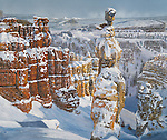 "Hoodoo rock formations line up in winter snow at Bryce Canyon park in Utah in a scenic western landscape. Oil on canvas, 24"" x 28""."