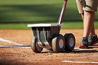 A grounds keeper draws the lines of the batters box prior to the start of game six the East Coast Pro Showcase at the Hoover Met Complex on August 3, 2020 in Hoover, AL. (Brian Westerholt/Four Seam Images)