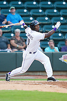 Courtney Hawkins (10) of the Winston-Salem Dash follows through on his swing against the Potomac Nationals at BB&T Ballpark on July 8, 2013 in Winston-Salem, North Carolina.  The Dash defeated the Nationals 12-9.  (Brian Westerholt/Four Seam Images)