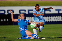 Rosana (11) of Sky Blue FC passes the ball as Stacy Bishop (4) of the Boston Breakers attempts a tackle. Sky Blue FC defeated the Boston Breakers 2-1 during a Women's Professional Soccer match at Yurcak Field in Piscataway, NJ, on May 31, 2009.