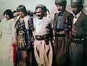 Iraq 1984  .<br /> In Qara Dagh,3rd right, Sheikh Jaffar dancing with peshmergas and women.<br /> Irak 1984.<br /> Moment de detente dans le Qara Dagh, 3eme a droite, Sheikh Jaffar dansant avec des femmes et des peshmergas