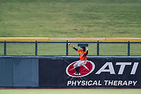 AZL Giants center fielder Ismael Munguia (29) attempts a leaping catch at the wall in left-centerfield against the AZL Cubs on July 17, 2017 at Sloan Park in Mesa, Arizona. AZL Giants defeated the AZL Cubs 12-7. (Zachary Lucy/Four Seam Images)