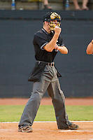 Home plate umpire Charlie Tierney makes a strike call during an Appalachian League game between the Pulaski Mariners and the Bristol White Sox at Boyce Cox Field August 28, 2010, in Bristol, Tennessee.  Photo by Brian Westerholt / Four Seam Images