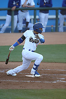 Jorbit Vivas (14) of the Rancho Cucamonga Quakes bats against the Modesto Nuts at LoanMart Field on May 14, 2021 in Rancho Cucamonga, California. (Larry Goren/Four Seam Images)