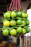 Limes and chillies are decoratively threaded onto strings and on sale for offering outside the Kalighat Kali temple.