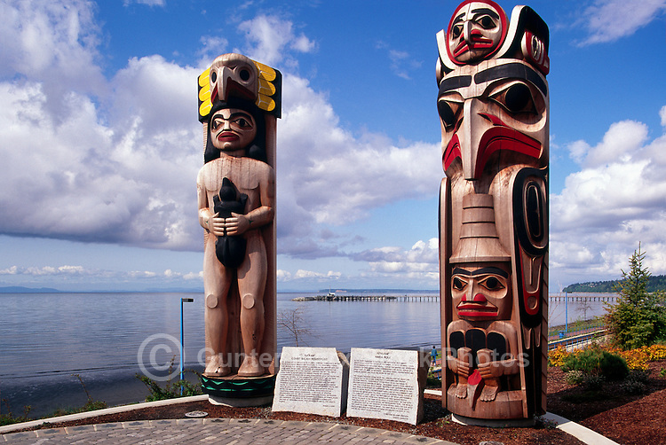 White Rock, BC, British Columbia, Canada - Coast Salish and Haida Totem Poles in Lions Park, along Seaside Promenade Walkway and Semiahmoo Bay