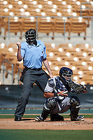 Umpire Nic Lentz makes a call behind catcher Gary Sanchez (78) during an Arizona Fall League game between the Surprise Saguaros and Glendale Desert Dogs on October 24, 2015 at Camelback Ranch in Glendale, Arizona.  Surprise defeated Glendale 18-3.  (Mike Janes/Four Seam Images)