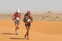 4th October 2021; Tisserdimine to Kourci Dial Zaid;  Marathon des Sables, stage 2 of  a six-day, 251 km ultramarathon, which is approximately the distance of six regular marathons. The longest single stage is 91 km long. This multiday race is held every year in southern Morocco, in the Sahara Desert. Aicha Omrani (FRA) running in the top ten women