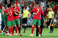 1st September 2021; Faro, Algarve, Portugal:  Portugals forward Cristiano Ronaldo celebrates with Portugals head coach Fernando Sant2nd R after the FIFA World Cup,  2022 European qualifying round group A football match between Portugal and Ireland in Faro, Portugal