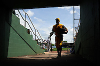 Jacksonville Suns Zack Cox (20) walks to the bus through a tunnel after the 20th Annual Rickwood Classic Game against the Birmingham Barons on May 27, 2015 at Rickwood Field in Birmingham, Alabama.  Jacksonville defeated Birmingham by the score of 8-2 at the countries oldest ballpark, Rickwood opened in 1910 and has been most notably the home of the Birmingham Barons of the Southern League and Birmingham Black Barons of the Negro League.  (Mike Janes/Four Seam Images)