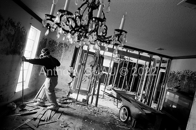 New Orleans, Louisiana.USA.February 20, 2006..Gregory Johnson and his 15 year old son Darren (in red blazer)  gutted their home after hurricane Katrina in East New Orleans.....
