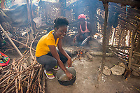 "Haiti, Gros-Morne. The home of Love-mica Dieujuste, a Mercy Beyond Borders scholar with her mother, Mislene Francois cooking in their kitchen. ""When you give my daughter a scholarship for education, you give me one as well."""