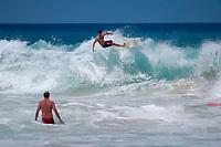 longboard surfer Jeff Sylva and bodyboarders during large surf at Magic sands beach, Kailua Kona The Big Island of Hawaii