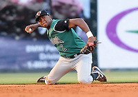 Shortstop Sharlon Schoop (2) of the Augusta GreenJackets throws out a runner from his knees in a game against the Greenville Drive on May 20, 2010, at Fluor Field at the West End in Greenville, S.C. Photo by: Tom Priddy/Four Seam Images
