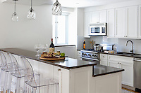 White cupboards in open plan kitchen