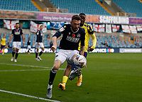 31st October 2020; The Den, Bermondsey, London, England; English Championship Football, Millwall Football Club versus Huddersfield Town; Tom Bradshaw of Millwall controlling the ball