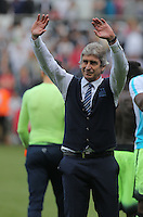 Manuel Pellegrini, Manager of Manchester City thanks away supporters during the Swansea City FC v Manchester City Premier League game at the Liberty Stadium, Swansea, Wales, UK, Sunday 15 May 2016