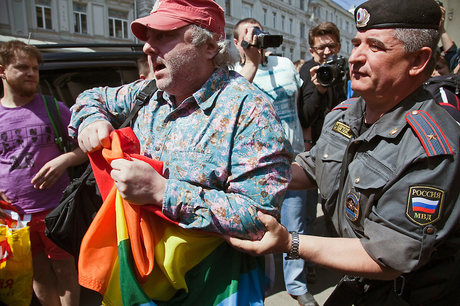 Moscow, Russia, 27/05/2012..Police arrest a gay activist unfurling a banner during clashes as Russian nationalists attacked gay rights activists during their seventh attempt to hold a gay pride parade in the Russian capital.