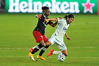 WASHINGTON, DC - SEPTEMBER 27: Lee Nguyen #42 of New England Revolution battles for the ball with Yordi Reyna #29 of D.C. United during a game between New England Revolution and D.C. United at Audi Field on September 27, 2020 in Washington, DC.