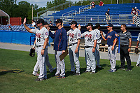 Tri-City ValleyCats coaching staff - including manager Morgan Ensberg (14), pitching coach Bill Murphy (jacket), coach Sig Medal (21), hitting coach Jeremy Barnes (20), rover Jeff Albert, and trainer Daniel Cerquera - high five players after closing out a game against the Batavia Muckdogs on July 16, 2017 at Dwyer Stadium in Batavia, New York.  Tri-City defeated Batavia 13-8.  (Mike Janes/Four Seam Images)