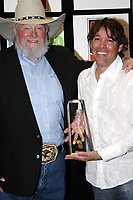 06 July 2020 - Country music and southern rock legend Charlie Daniels has passed away after suffering a stroke. The Grand Ole Opry member and Country Music Hall of Famer was 83. File Photo: 05 March 2008 - Nashville, Tennessee - Charlie Daniels and Clay Walker. Charllie Daniels presented Clay Walker with the Humanitarian Award during Country Radio Seminar (CRS). Photo Credit: Randi Radcliff/AdMedia