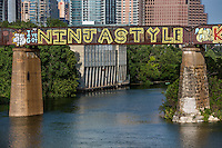 "Austin has a rich heritage of public art murals such as the ""I've Got NINJA STYLE"" is a fun and catchy graffiti mural painting on the Austin Railroad Graffiti Bridge over Lady Bird Lake, Austin, Texas."