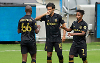 LOS ANGELES, CA - OCTOBER 25: Carlos Vela #10 of LAFC celebrates his goal with teammates Bradley Wright-Phillips #66 and Latif Blessing #7 during a game between Los Angeles Galaxy and Los Angeles FC at Banc of California Stadium on October 25, 2020 in Los Angeles, California.