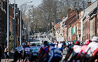 peloton up the Kruisberg where the 1988 World Championships finish line lay<br /> <br /> 76th Dwars door Vlaanderen 2021 (MEN1.UWT)<br /> 1 day race from Roeselare to Waregem (184km)<br /> <br /> ©kramon