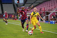 KASHIMA, JAPAN - AUGUST 5: Crystal Dunn #2 of the United States battles for the ball with Tameka Yallop #13 of Australia during a game between Australia and USWNT at Kashima Soccer Stadium on August 5, 2021 in Kashima, Japan.