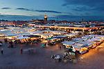 Morocco, Marrakech: Dusk view over Jemaa el Fna, since 2001 UNESCO Masterpiece of the Oral and Intangible Heritage of Humanity | Marokko, Marrakesch: Abenddaemmerung ueber dem Jemaa el Fna, zentraler Marktplatz und seit 2001 auf der UNESCO-Liste der Meisterwerke des muendlichen und immateriellen Erbes der Menschheit