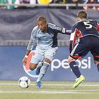 Sporting Kansas City forward Teal Bunbury (9) dribbles. In the first game of two-game aggregate total goals Major League Soccer (MLS) Eastern Conference Semifinal series, New England Revolution (dark blue) vs Sporting Kansas City (light blue), 2-1, at Gillette Stadium on November 2, 2013.