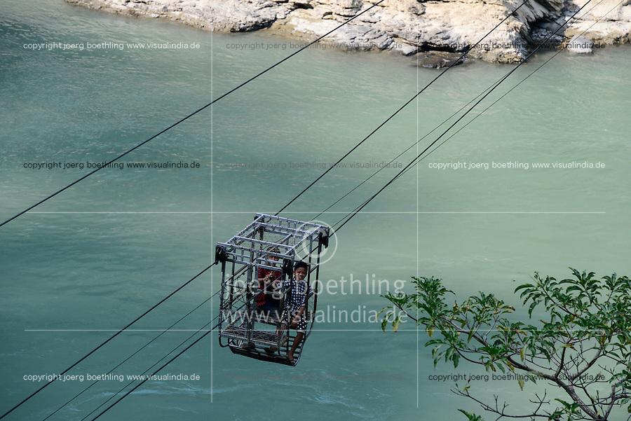 NEPAL , Mugling, village Karantar, children in cable car on river Daraudi / Kinder in einer Seilbahn am Fluss Daraudi
