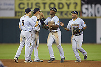 (L-R) Oliver Dunn (8), Oswald Peraza (5), Josh Stowers (21), and Canaan Smith (15) celebrate their win over the Hickory Crawdads at L.P. Frans Stadium on August 10, 2019 in Hickory, North Carolina. The RiverDogs defeated the Crawdads 10-9. (Brian Westerholt/Four Seam Images)