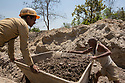India - Jharkhand - Dhab - Miners push a trolley full of mica in the only legal mine in the State of Jharkhand.