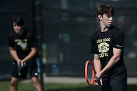 Little Rock Centrals' Alex Wells (right) and doubles partner Stefan Tudoreanu compete Tuesday, Oct. 12, 2021, during the 6A state tennis finals at Memorial Park in Bentonville. Visit nwaonline.com/211013Daily/ for today's photo gallery.<br /> (NWA Democrat-Gazette/Andy Shupe)
