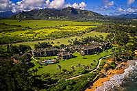 Aerial view of the Kaha Lani Resort in Lihu'e, Kauai, with the iconic Sleeping Giant still resting in his nap in the distance.