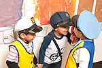 Education Preschool 3 year olds group of boys playing wearing dressup outfits and using toy telephones