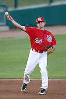 Adam Younger #49 of the Inland Empire 66'ers throws to first base  against the Modesto Nuts at Arrowhead Credit Union Park in San Bernardino,California on May 30, 2011. Photo by Larry Goren/Four Seam Images