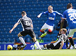 Rangers v St Mirren: Ryan Kent tackled by Marcus Fraser and Nathan Sheron