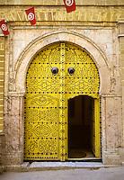 Tunisia.  Tunis Medina.  Doorway.  The high door knockers date from the era when guests arrived on horseback.