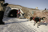 March 3, 2007.  Anchorage, Alaska.  Andrew Angstman runs through a culvert underpass on a bike trail in downtown Anchorage during the ceremonial start day of the Iditarod Trail Sled Dog Race