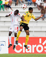 Jevani Brown (14) of Jamaica goes up for a header with Alexander Gonzalez (20) of Panama during the third place game of the CONCACAF Men's Under 17 Championship at Catherine Hall Stadium in Montego Bay, Jamaica. Panama defeated Jamaica, 1-0.