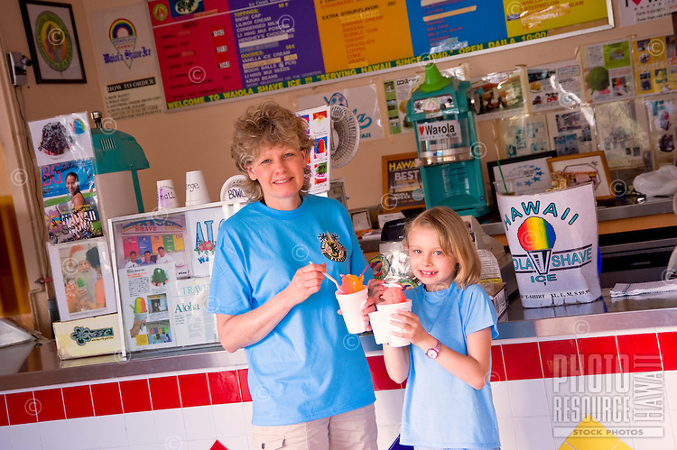 Mother and daughter eating at the Waiola Shave Ice store in Kapahulu