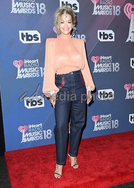 11 March 2018 - Inglewood, California - Rita Ora. 2018 iHeart Radio Awards - Press Room held at The Forum. Photo Credit: Birdie Thompson/AdMedia