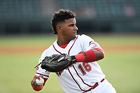 Catcher Roldani Baldwin (16) of the Greenville Drive warms up before a game against the Asheville Tourists on Wednesday, August 2, 2017, at Fluor Field at the West End in Greenville, South Carolina. Greenville won, 1-0. (Tom Priddy/Four Seam Images)