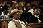 Church  of God of Prophecy west London. A  member of the congregation listens to the Sunday sermon. <br /> from A STORM IS PASSING OVER a Look at Black Churches in Britain. Published by Thames and Hudson isbn 0 500 27826 1